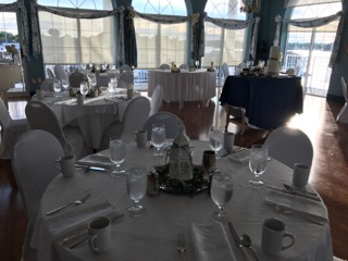 tables with flatware and white linens